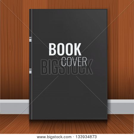 Mockup of black book cover. Realistic Textbook, booklet, notepad or notebook for your design and branding with wood wall background.