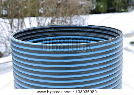 Plastic striped pipe repair manhole ring close-up
