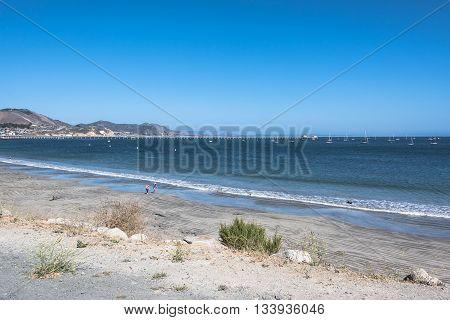 The sand beach along the coast of Avila Beach, California