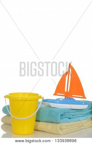 beach toys and towels with copy space