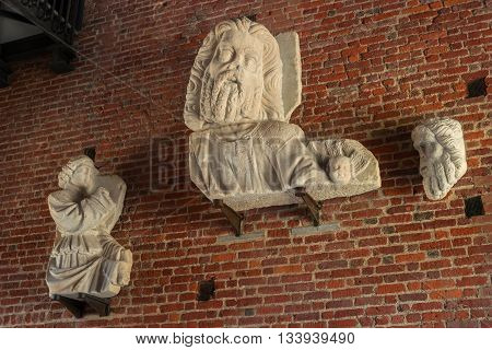 Milan Italy - May 25 2016: head sculpture from gate of Sforza castle. It was built in the 15th century by Francesco Sforza Duke of Milan