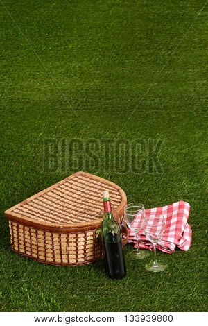 picnic with red wine on artificial grass