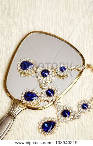 closeup of vintage sapphire necklace and mirror