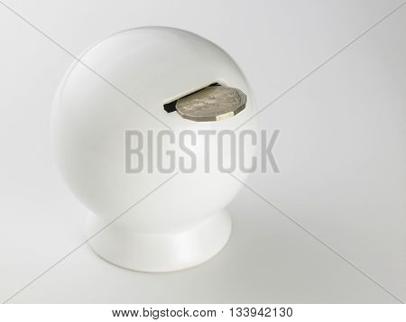 round saving coin box on the white background