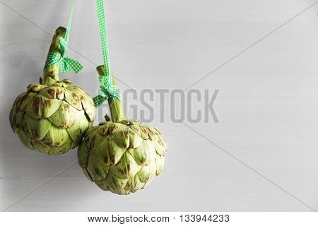 Artichokes on white wooden background