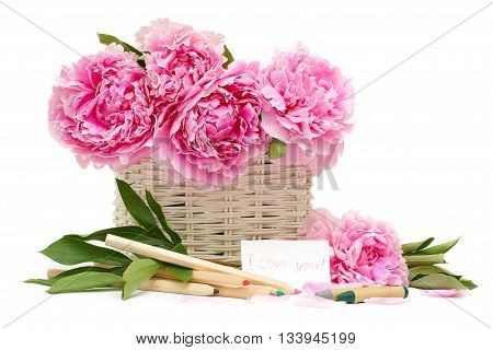 Gift. Bouquet of flowers and a note with a declaration of love isolated on white background