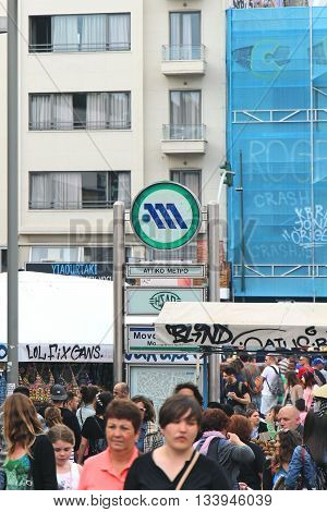ATHENS GREECE - MAY 02; Sign of Athens metro entrance outside Monastiraki stop in Athens Greece - May 02 2015: Monastiraki underground station entrance with crowd of people walking around in Athens.