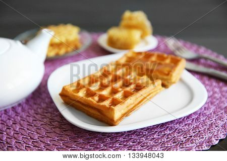 Breakfast with Belgian waffles and honey
