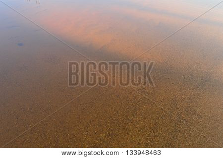 The solar shade on the water surface of a sandy beach