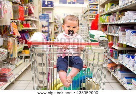 baby shopping cart newborn supermarket consumerism background