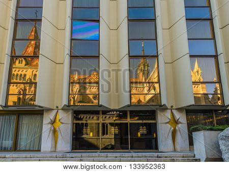 BUDAPEST- MAY 26: Reflection of church Matthiaskirche in front of Hilton Hotel in Castle district of Buda on May 26, 2016 in Budapest, Hungary.
