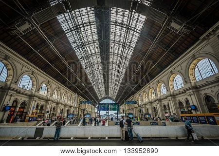 BUDAPEST- MAY 28: People are moving through the interior of Train Station Keleti Palyudvar on May 28, 2016 in Budapest, Hungary.