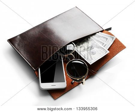Leather purse with mobile phone, glasses and dollar banknotes, isolated on white