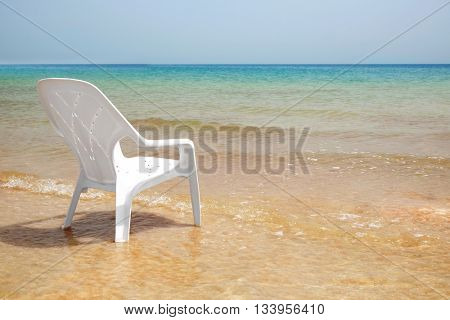Chair on the beach of Dead Sea