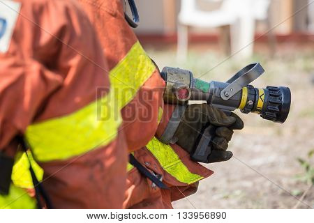 fireman hand in glove hold fire fighting nozzle