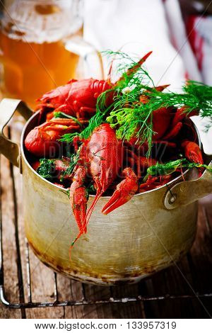 boiled crayfish with dill in a vintage metal pan. style rustic. selective focus