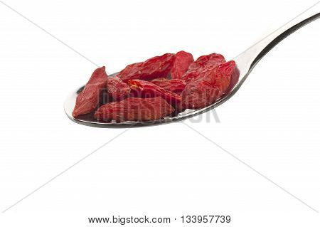 Spoon with Group of Goji berry on the white