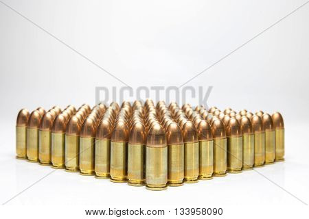 row of 9 mm bullets isolated on white background