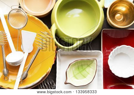 The colorful dishes and utensils close up