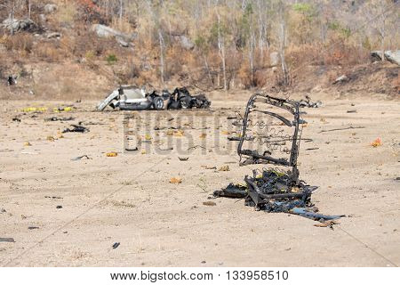 part of car seat and car wrecked from car bomb