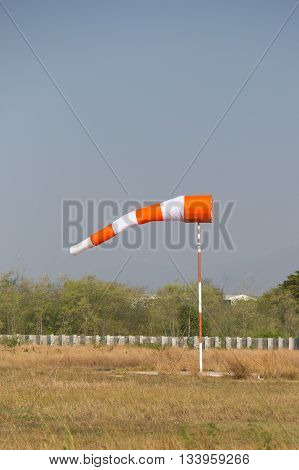 orange white reflective windsock at parachute drop zone and airfield