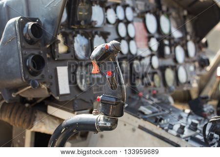 vintage helicopter flight control and cockpit with instrument panel background