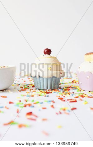 Cupcake and colorful sprinkle on a white background