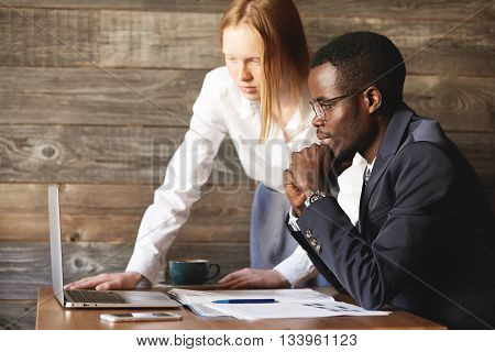 Business And Career Concept. Teamwork And Cooperation: African Man In Formal Suit And Caucasian Woma