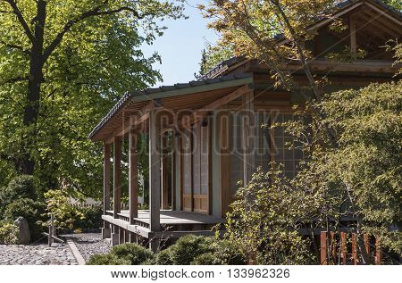 wooden house with a garden in the Japanese style
