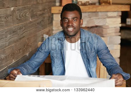 Handsome Black Man In Denim Jacket Over White T-shirt Looking At The Camera With Happy Ultrawhite Sm