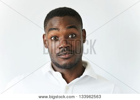 Human Face Expressions And Emotions. Amazed Black Student Or Employee In White Polo Shirt, Looking A