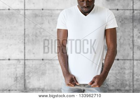 Portrait Of Handsome Young African American Student Stretching White Blank T-shirt With Copy Space F
