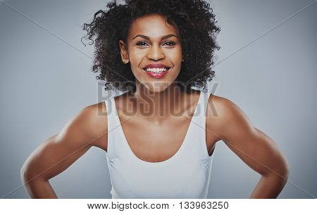 Smiling Female Leaning Forward On Gray Background