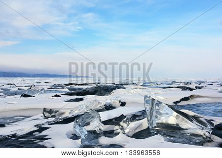 Frozen lake covered with snow and ice hummocks