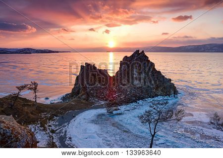 Stunning sunset above the frozen surface of the lake Baikal on the Olkhon iceland