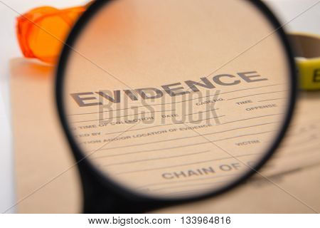 magnifying glass focus on evidence bag and