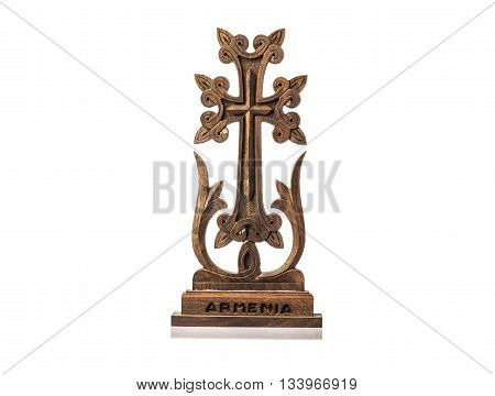 The hachkar wood cross from Armenia isolated on white