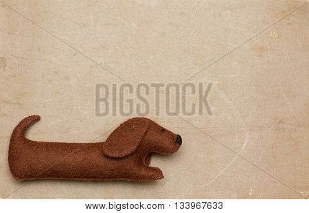 little Dog toy on old paper brown background