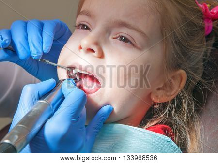 modern dental clinic young dentist working. Close up