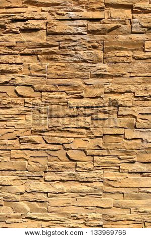 old stone wall Texture in weathered and have natural surfaces for design background.