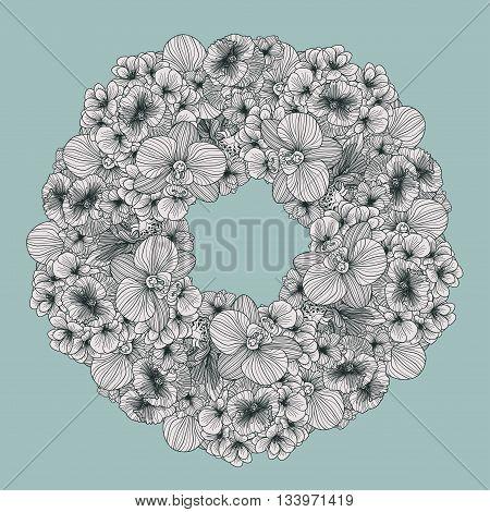 Frame made of vintage flowers on teal background
