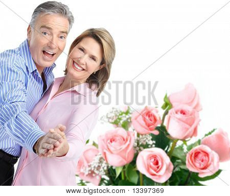 Happy seniors couple in love with flowers.  Isolated over white background