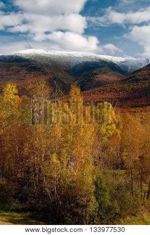 Even during autumn foliage New Hampshire's White Mountains may have snow on their tops.