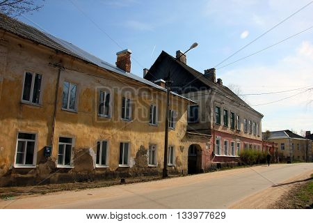 Provincial town street with old brick and plaster yellow and red houses Torzhok Russia