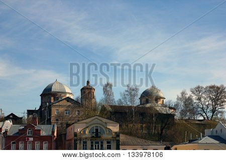 City view with old shabby russian brick church building Torzhok Russia