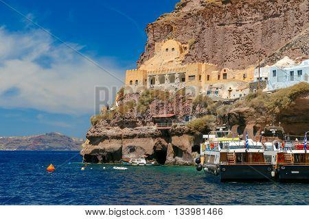Mesa Gialos, Old Port of Fira, modern capital of the Greek Aegean island, Santorini, in the sunny day, Greece