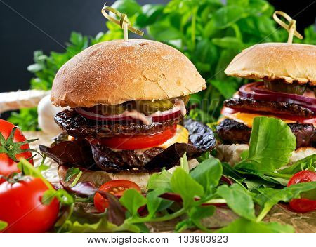 Juicy homemade Burger with beef patty, mushroom and vegetables.