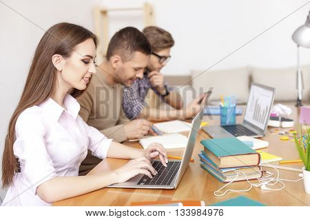 They want to to do well in this upcoming exam. Young students busy performing tasks, using computers, preparing for exams