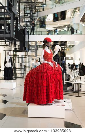 BANGKOK, THAILAND - JUNE 8, 2016 : Manikin wears red long dress in Siam Discovery, one of the most famous shopping mall in Bangkok, Thailand