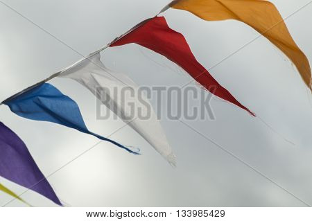 Bunting flag banners flapping in the air flashing theircolor